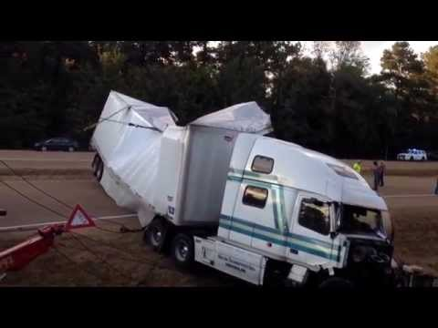 18 wheeler's trailer ripped apart by three chops wreckers. accident occurred october 31, 2014.