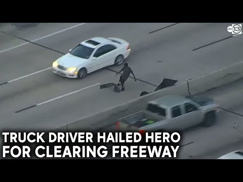 Passenger of 18-wheeler hops out of cab and removes debris off freeway