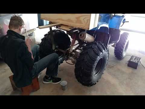 Finally putting the bigger tires on the atv, they are freaking huge compared to the size of the atv.